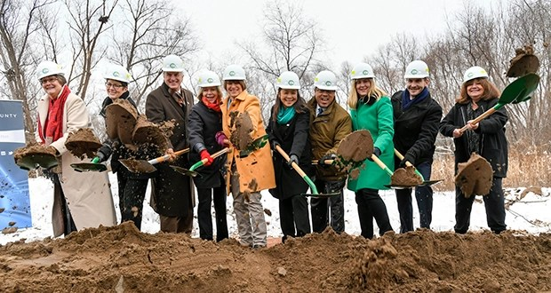 The dirt flies Friday in Hopkins during the groundbreaking for the Southwest light rail line. Pictured are, from left Hopkins Mayor Molly Cummings, Hennepin County Board Chair Jan Callison, Hennepin County Commissioner Peter McLaughlin, U.S. Sen. Tina Smith, U.S. Sen. Amy Klobuchar, Metropolitan Council Chair Alene Tchourumoff, U.S. Rep. Keith Ellison, Minnesota House Speaker-elect Melissa Hortman, Minneapolis Chamber of Commerce President and CEO Jonathan Weinhagen and Met Council Member Gail Dorfman. (Photo: Craig Lassig/Special to Finance & Commerce)