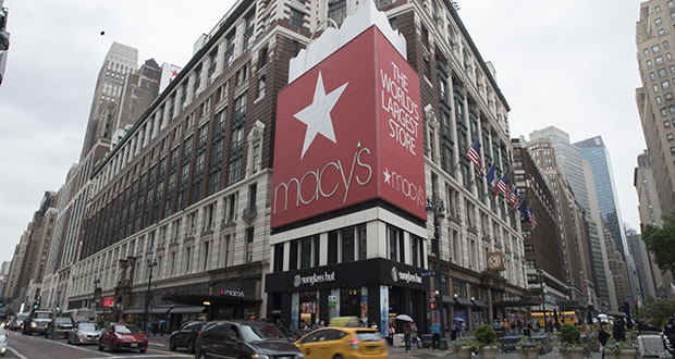 Macy's Inc. reported third-quarter profits of $62 million on Wednesday. In this May 16 photo, traffic makes its way past the Macy's flagship store in New York. (AP file photo)