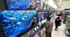 Sales at general merchandise stores, which include big box retailers such as Walmart and Target, increased 0.5 percent in October, the Commerce Department reported Thursday. In this Nov. 9 photo, shoppers look at televisions at a Walmart Supercenter in Houston. (AP file photo)