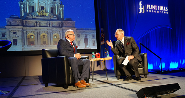 Gov. Tim Walz and Minnesota Chamber of Commerce President Doug Loon speak on stage last year at the Chamber's annual Session Priorities event. (Submitted photo: Minnesota Chamber)