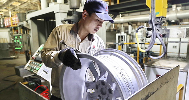A laborer works on an aluminum wheel hub Feb. 11 at a manufacturing facility in Qinhuangdao in northern China's Hebei province. U.S. and Chinese negotiators meet this week for their final trade talks before President Donald Trump decides whether to go ahead with a March 2 tariff hike on $200 billion of imports from China. (Photo: Chinatopix via AP)