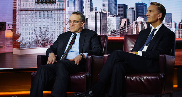 Howard Marks, co-founder of Oaktree Capital Group LLC, left, speaks while Bruce Flatt, chief executive officer of Brookfield Assest Management Inc., listens during a Bloomberg Interview March 21 in New York. Brookfield's acquisition of Oaktree is key to its attempt to transform its $42 billion private-equity business into a giant. (Bloomberg photo: Christopher Goodney)