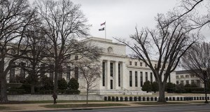 Federal Reserve officials have made it clear they want to go back to owning mostly Treasurys, as they did before the financial crisis, but it's unclear how the central bank will get there or what it will buy. This photo shows the Federal Reserve building in Washington. (Bloomberg file photo)