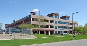 The parking garage at 3700 American Blvd. E. was built in the 1990s for an office project that never happened. Now Bloomington wants to see new development on the adjacent surface parking lot and end remote airport parking at the site. (Submitted photo: CoStar Group)