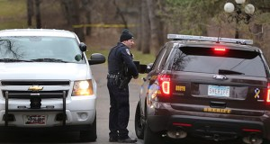 Law enforcement personnel confer outside a home in Orono Wednesday. Authorities say bodies of a male and female were discovered at the home about 8:30 a.m. Wednesday. (Star Tribune via AP)