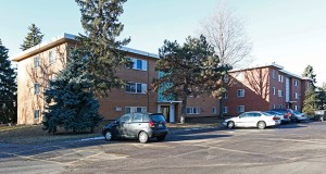 Minneapolis-based EIG Property Management has added to its portfolio of mid-century apartments with 84 units in the Fuller Avenue Apartments at 250-310 Fuller Ave. in St. Paul. (Submitted photo: CoStar)