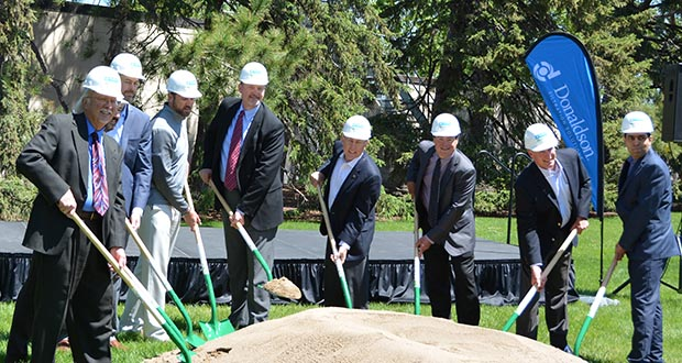 Bloomington Mayor Gene Winstead, Donaldson Co. CEO Tod Carpenter and other officials break ground this week on a new $15 million R&D building for the company. Bloomington is moving to designate a large area on the east side of the city, including Donaldson's headquarters campus, as its Gateway Development District to spur further redevelopment. (Submitted photo: Bloomington Chamber)