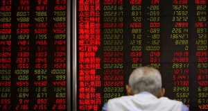 A Chinese investor monitors stock prices at a brokerage house in Beijing, Friday, May 31, 2019. (AP Photo/Mark Schiefelbein)