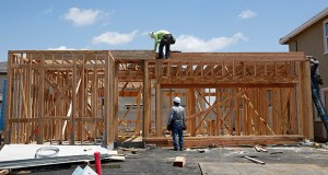 The National Association of Home Builders/Wells Fargo Housing Market Index fell two points to 64 in June, according to a report Monday. In this photo taken May 23, construction is done on a home in a housing development in Elk Grove, California. (AP file photo)