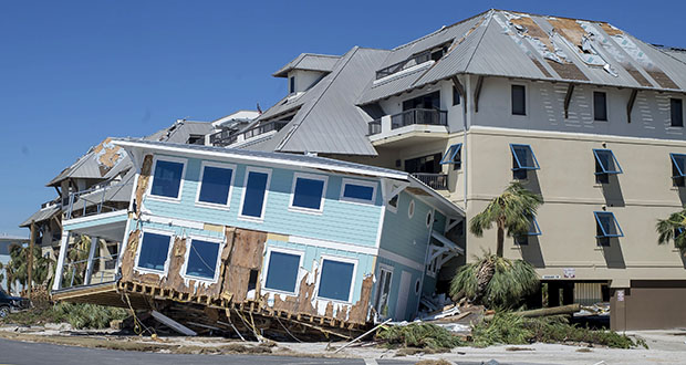 In 2018, Hurricane Florence (Category 4) and Hurricane Michael (Category 5) combined to cause an estimated total of $50 billion in damages in the U.S. This Oct. 12, 2018 photo shows a house damaged after Hurricane Michael hit in Mexico Beach, Florida. (Bloomberg file photo)