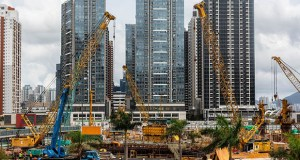 Cranes stand at a construction site at the former Kai Tak airport area. (Bloomberg photo: Eduardo Leal)