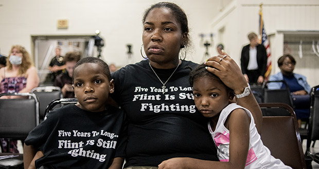 Flint resident Ariana Hawk consoles her son Sincere Smith, left, and Aliana Hawk, 4, nearing the end of a two-hour community meeting with Flint water prosecutors at UAW Local 659 on June 28 in Flint, Michigan. Sincere Smith graced the cover of Time magazine at the height of the Flint water crisis in 2016. Michigan Solicitor General Fadwa Hammoud and Wayne County Prosecutor Kym Worthy spoke to residents Friday night, two weeks after dismissing charges against the former state health director and other officials. (Photo: Jake May/MLive.com/The Flint Journal via AP)