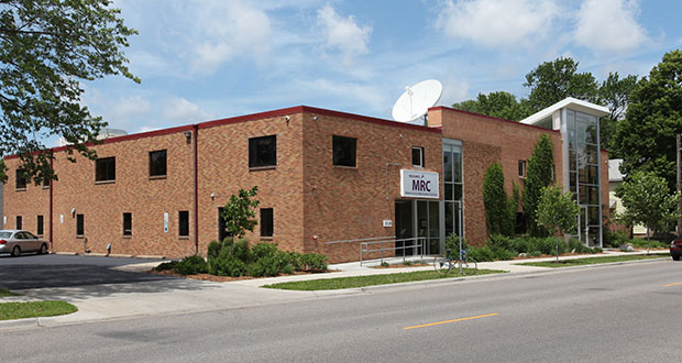 The Leech Lake Band of Ojibwe has paid $2.9 million in cash to acquire the former Captionmax headquarters building at 2438 27th Ave. S. in Minneapolis. The building has been partially vacant since Captionmax moved to 275 Market St. in Minneapolis. (Submitted photo: CoStar)