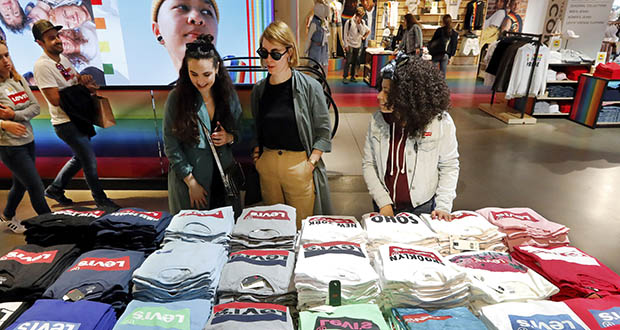 Clothing prices increased 0.4% in July, the Labor Department said Tuesday. In this June 14 photo, shoppers survey a T-shirt display at the Levi's store in New York's Times Square. (AP file photo)