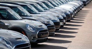 U.S. orders for transportation equipment powered the overall gain in durable goods, rising 7%, its strongest month in almost a year. Orders for motor vehicles and parts rose 0.5%. This Aug. 25 photo shows a long line of unsold Clubman sports-utility vehicles at a Mini dealership in Highlands Ranch, Colorado. (AP photo)