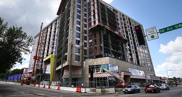 U.S. apartment building starts plunged 17.2% in July, the commerce Department said Friday.  This July 26 photo shows the Berkman Apartments under construction at 217 14th Ave. SW in Rochester. (Photo: Bill Klotz/Special to Finance & Commerce)