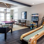 The game room is where Reserve tenants can let loose, particularly with a sports simulator that includes soccer and golf programs. (Submitted photo: Doran Cos.)