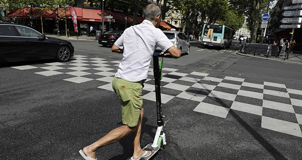 A man rides an electric scooter in Paris on Monday. The French government is meeting with people who've been injured by electric scooters as it readies restrictions on vehicles that are transforming the Paris cityscape. The Transport Ministry says Monday's closed-door meeting is part of consultations aimed at limiting scooter speeds and where users can ride and park them. (AP Photo: Lewis Joly)