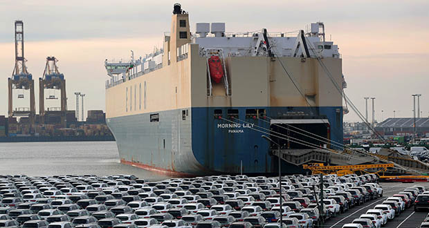 Germany has spewed wretched economic data for weeks: an 8% annual fall in exports in June and a 1.5% drop in industrial production in June from the month before. In this photo, rows of new automobiles stand on the dockside ahead of export as a cargo ship sits docked at the Port of Bremerhaven in Bremerhaven, Germany, in January. (Bloomberg file photo)