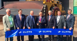 Cleveland Cliffs CEO Lourenco Goncalves, flanked by current 8th District Congressman Pete Stauber and former Congressman Rick Nolan, cuts the ceremonial ribbon on Tuesday, Aug. 6, 2019. (Dan Kraker/Minnesota Public Radio via AP)