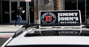 In this Feb. 6, 2019, photo, Tyler Schwecke, a delivery driver for Jimmy John's, makes a delivery in Las Vegas. (AP Photo/John Locher, File)