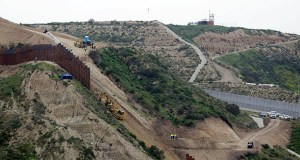 In this March 11, 2019 photo, construction crews replace a section of the primary wall separating San Diego, above right, and Tijuana, Mexico, below left, seen from Tijuana, Mexico. (AP file photo)