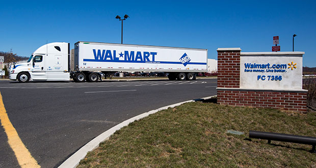 Walmart's introduction of technology that reduces energy use when trucks or idling and software that creates more efficient routes can improve fuel efficiency by 90%, reducing carbon dioxide emissions and saving on fuel costs. (Bloomberg file photo)