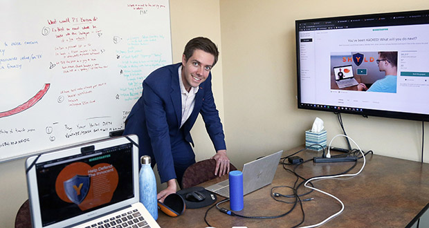 Tyler Olson poses in his office Aug. 27 at the University of St. Thomas' Minneapolis campus. Olson owns cybersecurity startup Shyld. (AP Photo: Jim Mone)