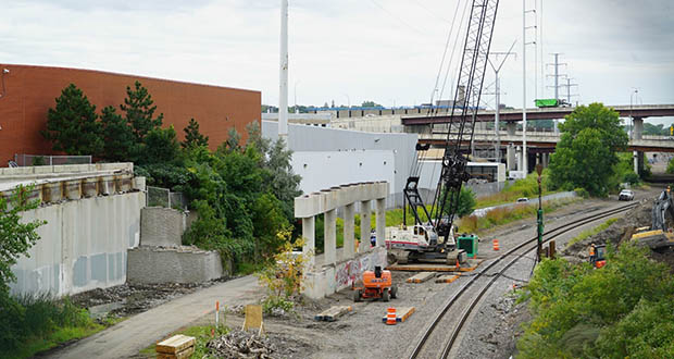 The closure of Glenwood Avenue between Lyndale Avenue North and 11th Street North for light rail construction began on July 15 and will last approximately two years. In this photo, the old Glenwood Avenue bridge is almost fully demolished. Crews removed the deck and girders that once spanned the rail corridor and bike trail. (Submitted photo: Metropolitan Council)
