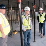 Kelly Doran (left) and Expo project executive Calvin Hayes (center) walk through one of the upper floors of the Expo tower. (Staff photo: Matt M. Johnson)