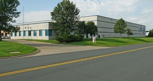 This 57,537-square-foot office-warehouse at 2922 W. Service Road in Eagan sold recently for $4.8 million, significantly higher than the $3.2 million the seller paid two years ago. (Submitted photo: CoStar)