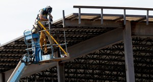 Nonresidential construction declined 1% in August, the Commerce Department said Tuesday, as spending on schools, hospitals and hotels were all down. This July 1 photo shows a construction worker atop a new building in Hillsborough, North Carolina. (AP file photo)
