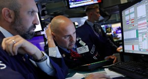 Specialists James Denaro, left, and Mario Picone work on the floor of the New York Stock Exchange on Wednesday. (AP Photo: Richard Drew)