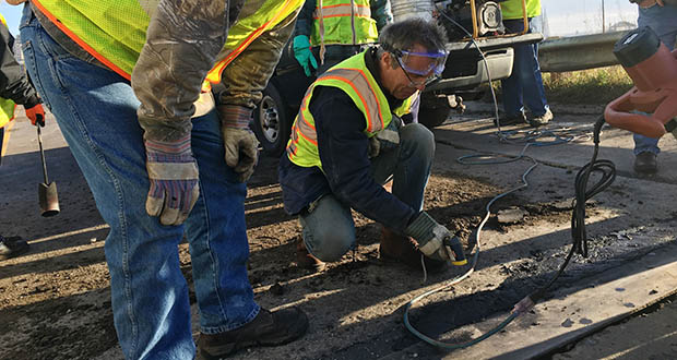 Researchers conduct field testing on an Interstate 35 exit ramp in Duluth for a pavement repair method that uses taconite mining materials and microwave technology. The testing was part of a 2016 demonstration project. (Submitted photo: UMD Natural Resources Research Institute)