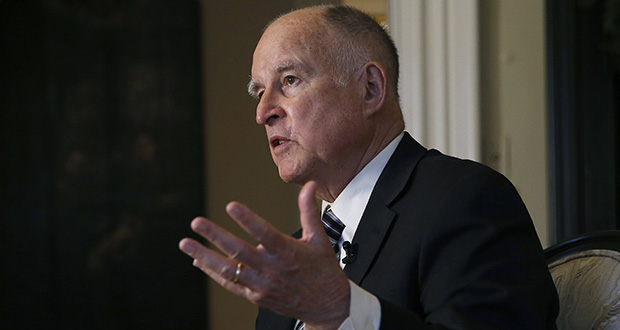 In this Tuesday, Dec. 18, 2018 file photo, then California Gov. Jerry Brown talks during an interview in Sacramento, Calif. California's first-in-the-nation law requiring publicly held companies to put women on their boards of directors faces its second legal challenge. Pacific Legal Foundation sued in federal court on Wednesday, Nov. 13, 2019, arguing that the law violates the U.S. Constitution's equal protection clause. (AP Photo/Rich Pedroncelli, File)