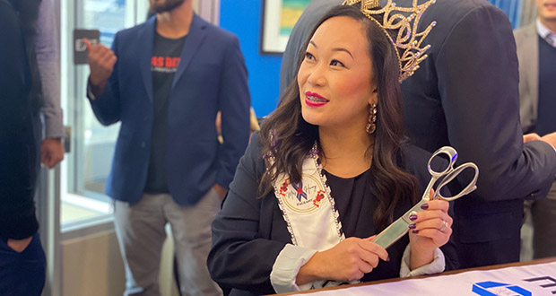 Chase St. Paul branch manager Macy Chang, who appeared in her regalia as Twin Cities Mrs. Hmong 2019, prepares to cut the ribbon Thursday at 1039 Grand Ave. (Submitted photo: Chase)