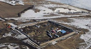 This Feb. 13, 2017, aerial file photo, shows a site where the final phase of the Dakota Access pipeline took place, with boring equipment routing the pipeline underground and across Lake Oahe to connect with the existing pipeline in Emmons County near Cannon Ball, North Dakota. (File photo: Tom Stromme/The Bismarck Tribune via AP)