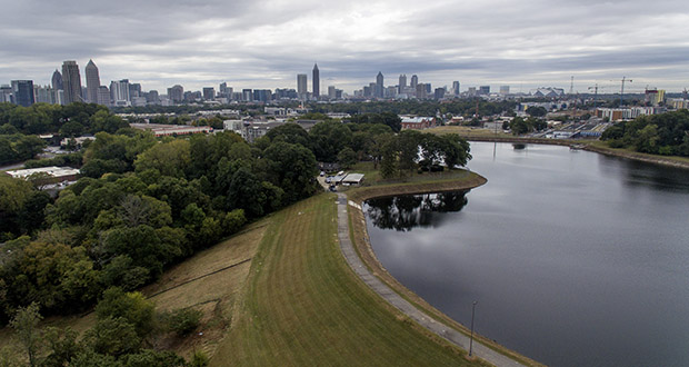 Reservoir No. 1, a 180 million-gallon water supply that has been out of service much of the past few decades, sits against the backdrop of the city skyline, Oct. 15, in Atlanta. The city made repairs and brought it back online in 2017, only to shut it down again after water leaks were noticed near businesses located beneath the dam. Were the dam to catastrophically fail, the water could inundate more than 1,000 single-family homes, dozens of businesses, a railroad and a portion of Interstate 75, according to an emergency action plan. (AP Photo: David Goldman)