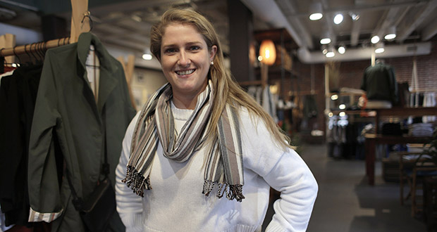 Annie Venditti, vice president of operations at clothing retailer American Rhino, stands for a photograph Nov. 14 in the company's store in Faneuil Hall Marketplace, in Boston. At the age of 23, Venditti was learning about the complexities of building and liquor laws. The company got a consultant to guide them. (AP Photo: Steven Senne)