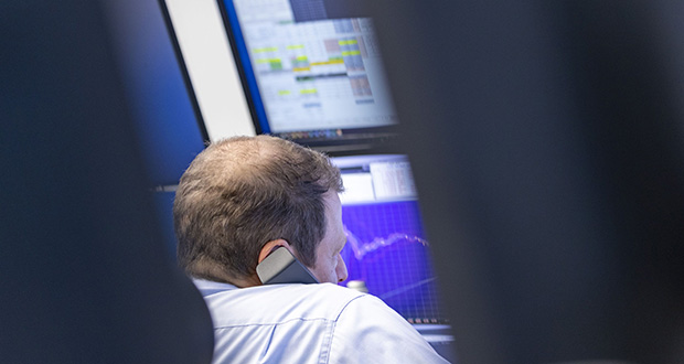 A trader works at the Frankfurt Stock Exchange on Oct. 16 in Frankfurt, Germany. (Bloomberg file photo)