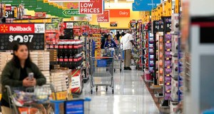 Walmart said Thursday that sales at stores opened at least a year rose 3.2%, marking the 21st straight quarter of gains. In this Nov. 9, 2018, photo, shoppers walk through the isles at a Walmart Supercenter in Houston. (AP file photo)