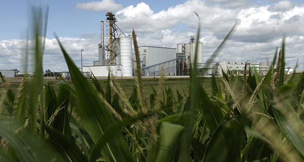 In this July 20, 2013, file photo, an ethanol plant stands next to a cornfield near Nevada, Iowa. (AP Photo/Charlie Riedel, File)