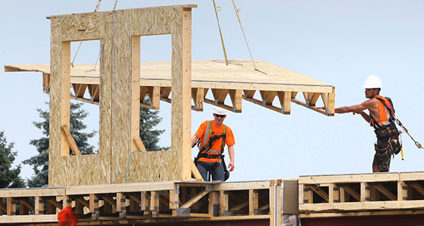 In this July file photo, a single-family house takes shape at Lennar's Rush Creek Commons development in Maple Grove. Permits for new single-family homes have surged in the second half of the year. (File photo: Bill Klotz)