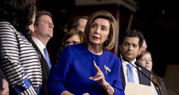 House Speaker Nancy Pelosi, accompanied by members of the House, speaks at a news conference Tuesday about the U.S.-Mexico-Canada Agreement, on Capitol Hill in Washington. (AP Photo: Andrew Harnik)