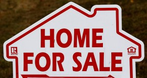 This Oct. 17, 2019, photo shows a home for sale sign in Orange County near Hillsborough, N.C. (AP Photo/Gerry Broome)
