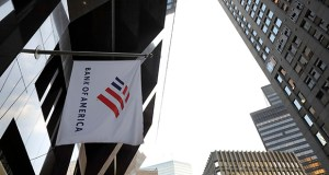 In this Oct. 14, 2019, file photo photo a Bank of America flag waves in front of the Bank of America Financial Center building, in Boston. (AP Photo/Steven Senne, File)