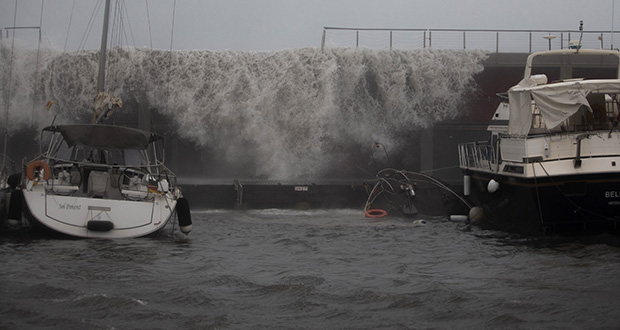 Waves hit the breakwater during a storm in Barcelona, Spain, Tuesday, Jan. 21, 2020. (AP Photo/Joan Mateu)