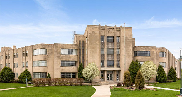 The former TIES office building at 1667 Snelling Ave., built in 1946 for the Farmers' Union Grain Terminal Association, is slated to become affordable housing under a proposal by Edina-based Buhl Investors. (Submitted photo: CoStar Group)