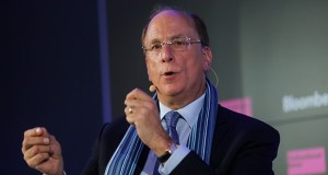 Larry Fink, chief executive officer of BlackRock Inc., gestures as he speaks during a Bloomberg event Tuesday on the opening day of the World Economic Forum in Davos, Switzerland. (Bloomberg photo: Simon Dawson)