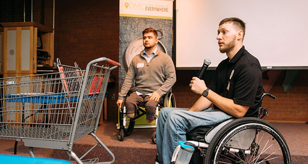 Cody Schmidt, front, and Nicholas Elliott present their proposal for a tool to help wheelchair users maneuver shopping carts and similar objects during the 2018 Assistive Tech Challenge. Their business idea, Adapt-A-Cart, won the competition's open division. (Submitted photo: Destination Medical Center Corp.)